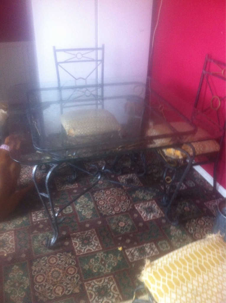 Wrought iron legs with glass table