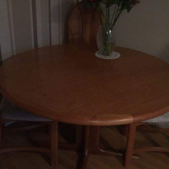 """Dining table and 4 chairs 47"""" diameter circular dining tables and chairs plus 2 extending panels opening table to 70"""". All in good condition. Must be able to collect"""