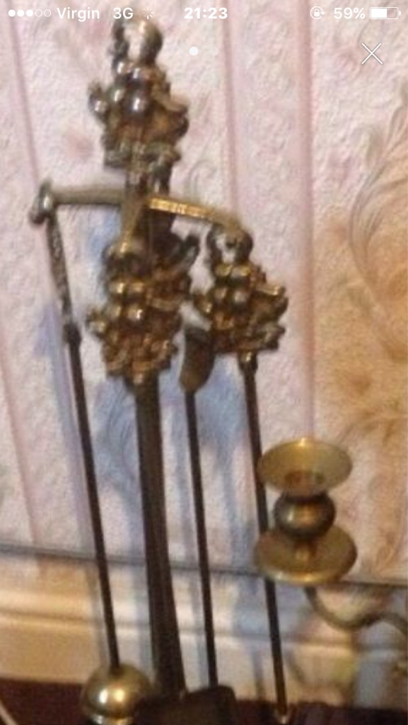 Fire side set brass poker set and candle holders brass heavy £25 each or whole set £60 offers pleas