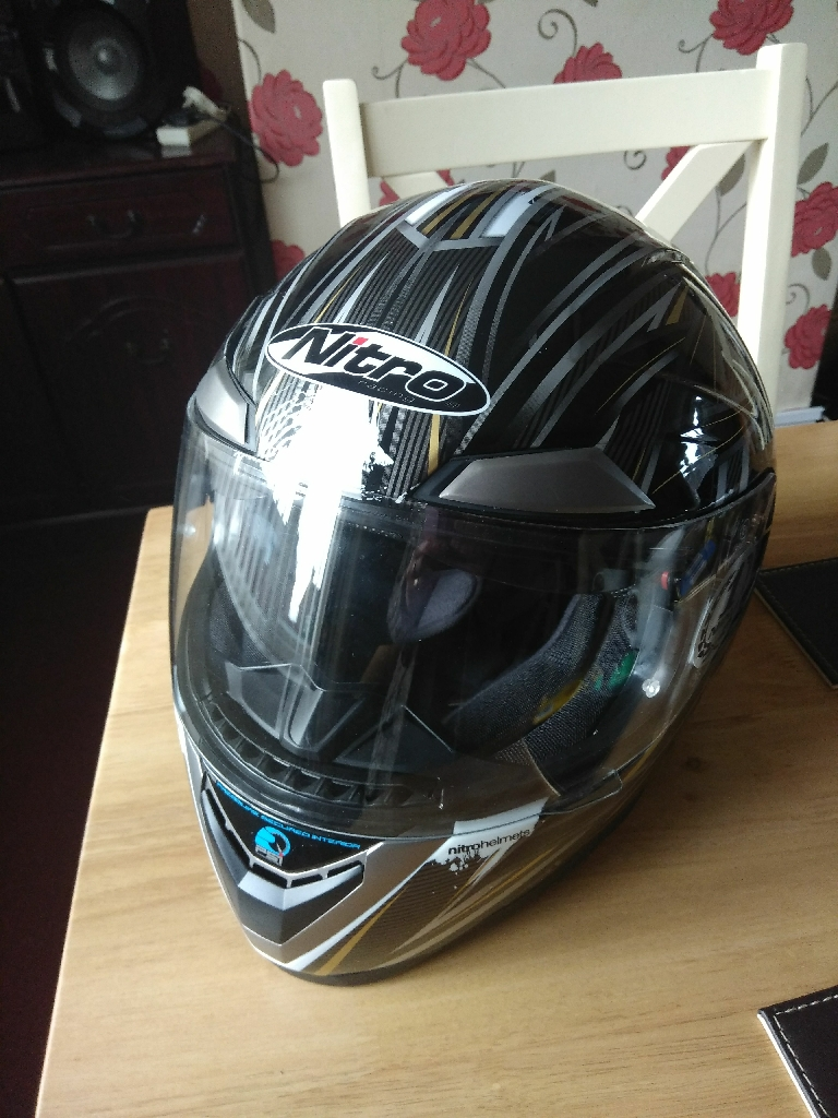 Breand new Motorcycle helmet with sunglasses built-in