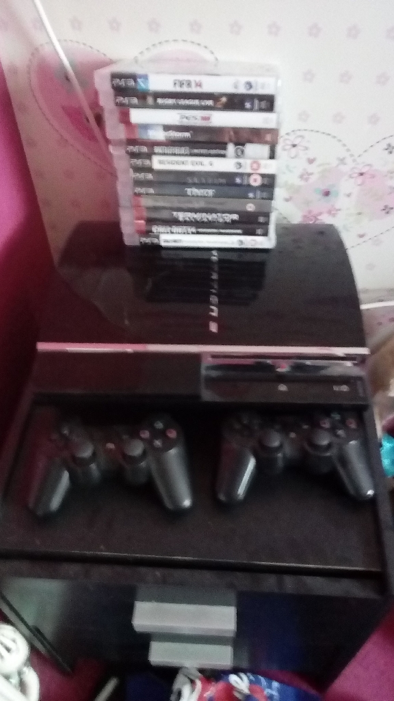 PS3 WITH 2 CONTROLLERS AND 12 GAMES