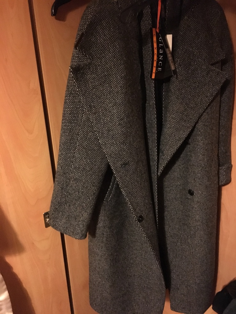 Woolen coat completely new with the tags yet attached