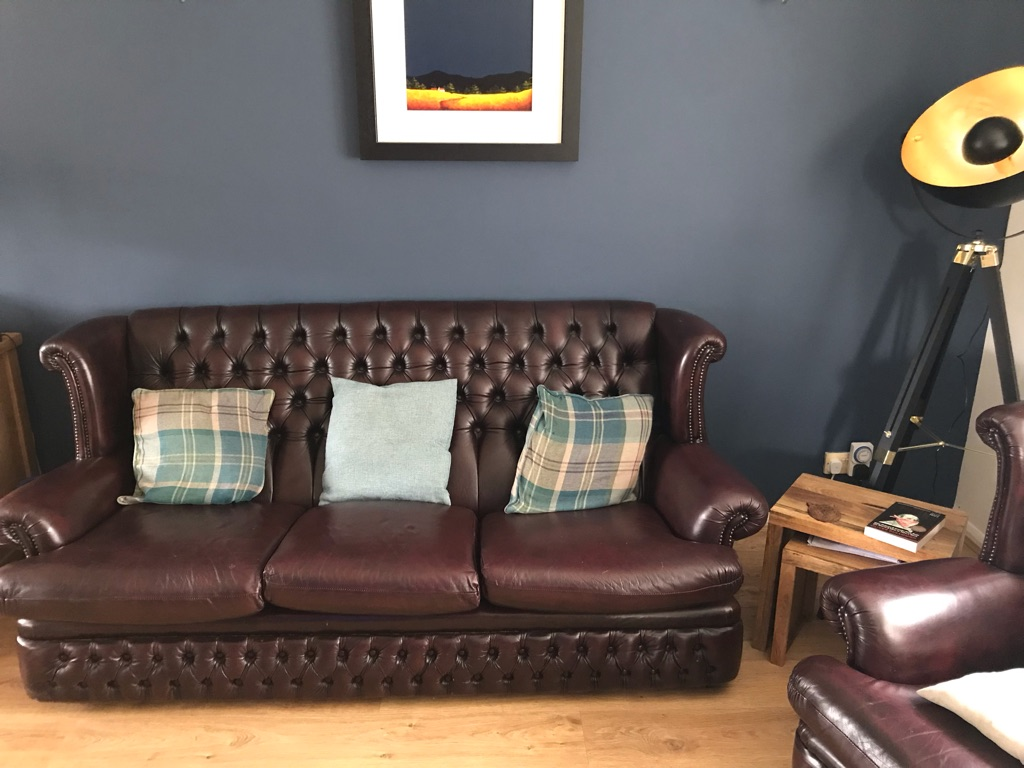 Oxblood Chesterfield sofa and two armchairs