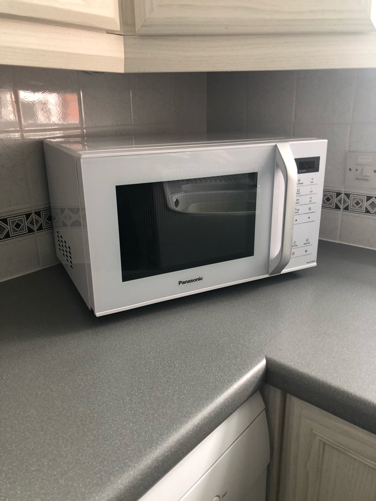 Brand new white Panasonic microwave