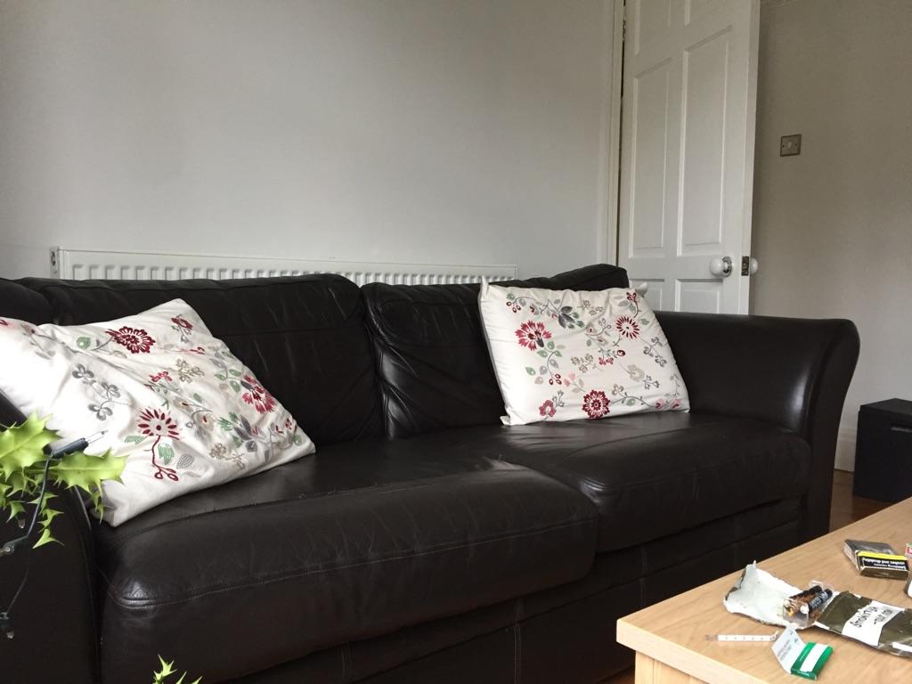 Sofa by NEXT. Rich dark brown leather