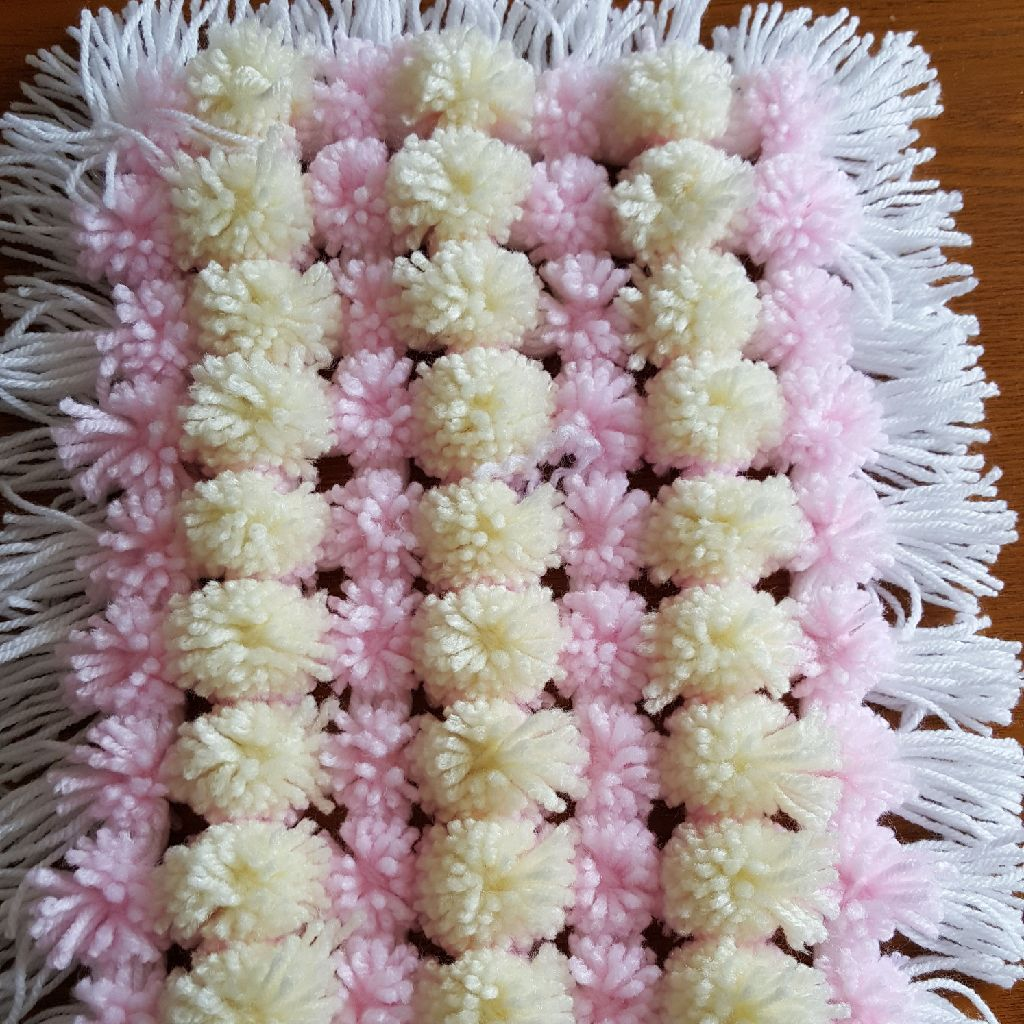 Handmade pom pom blanket for dolls
