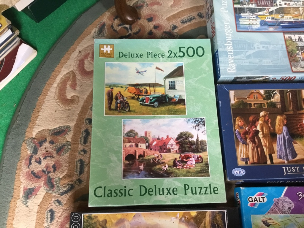 Job lot of 8 puzzles complete in sealed bag inside