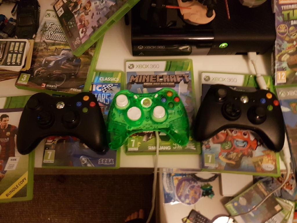 Xbox 360 ******with three controllers and games (plus docking station and figures)