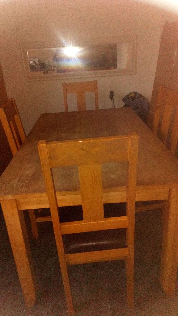 Hard wood dining table and 4 chairs