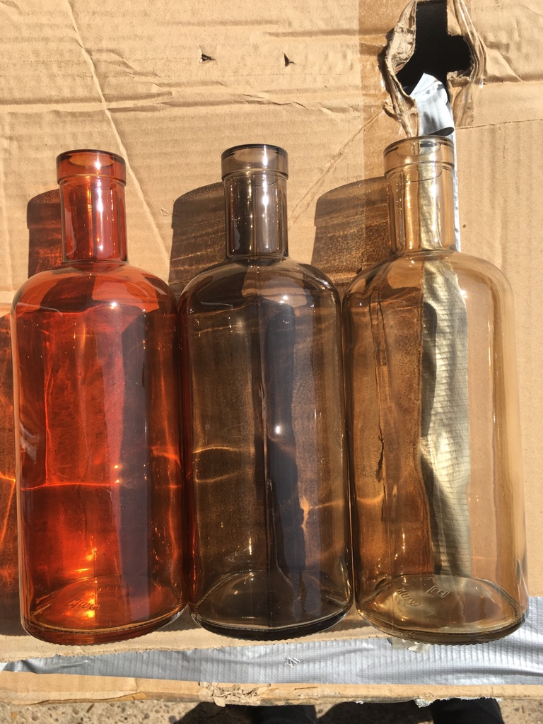 Three coloured glass bottles