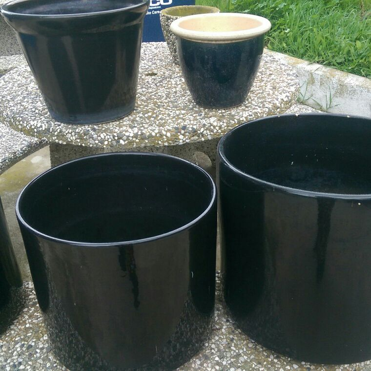 Black glazed ceramic pots