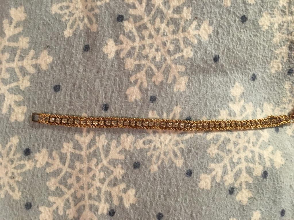 5 gold colored bracelets