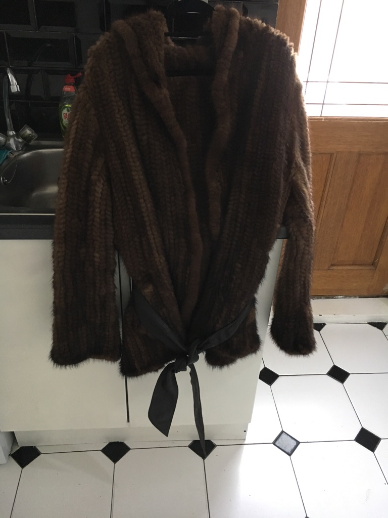 Mink coat with leather belt
