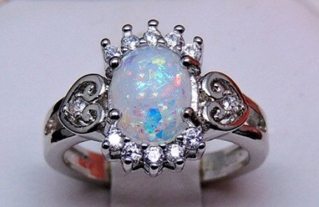 Oval shape fire opal with clear Accents ring