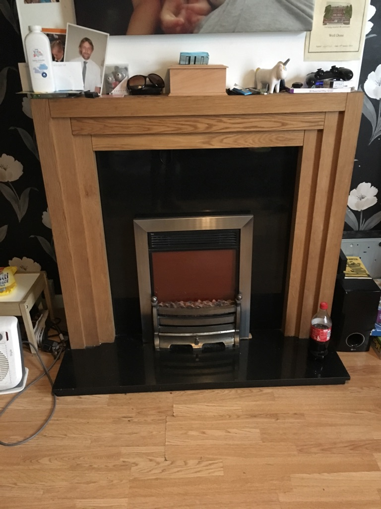 Fire surround with built in lights marble back and bottom and fire