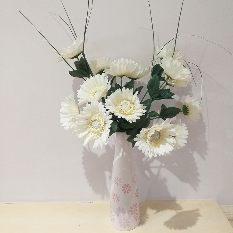 Pot vase with cream silk gerberas