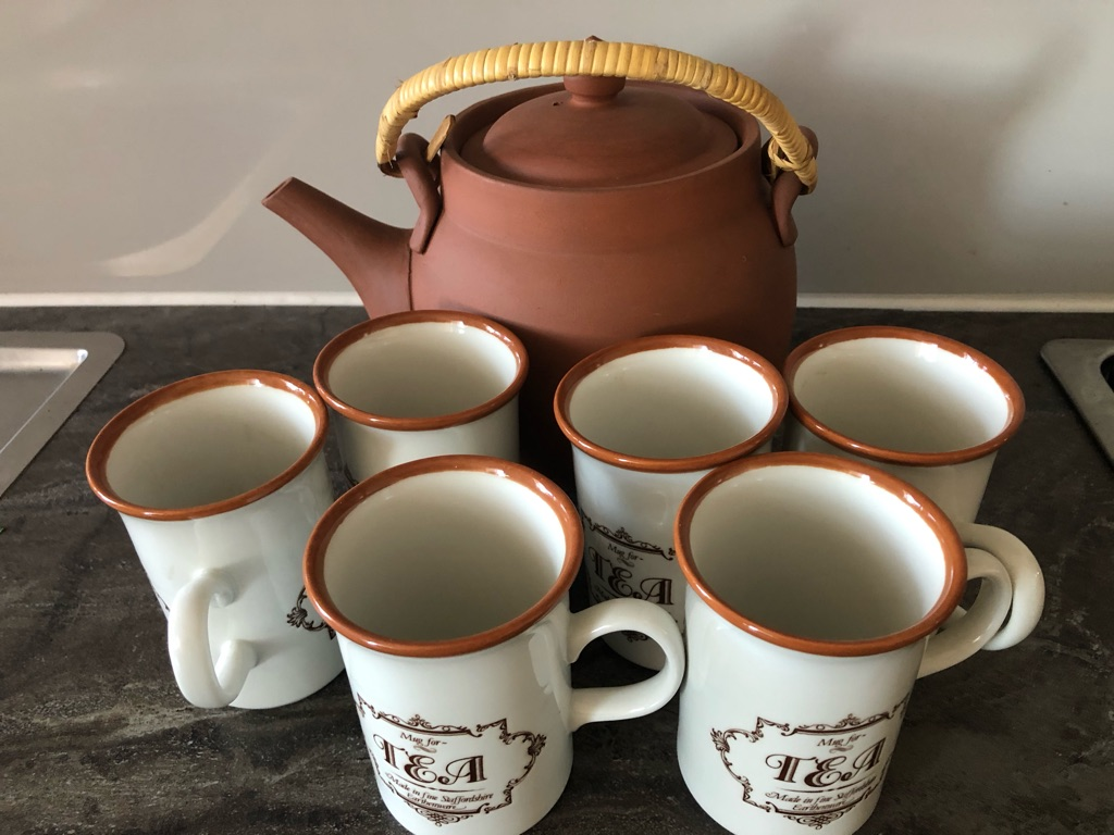 Tea service with a terracotta brewing jug.