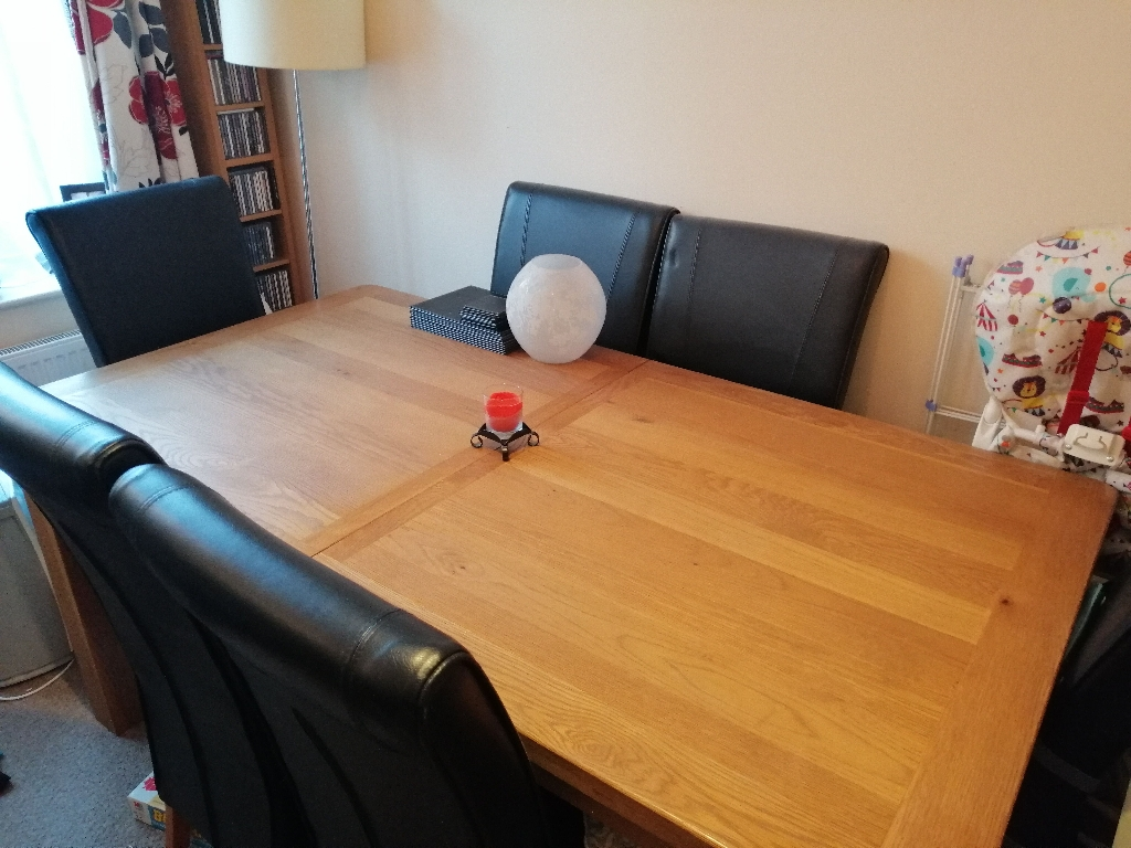 Extendable 8 seater solid wood table with 6 chairs