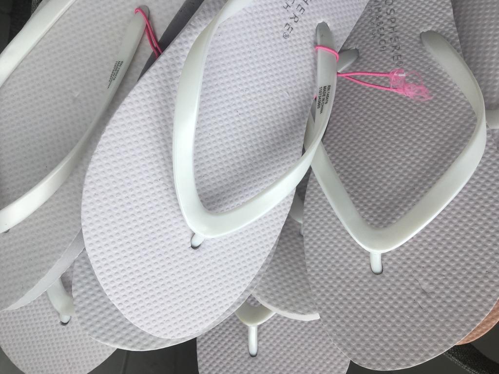 34 pairs of new unused flip flops for saving feet at wedding!
