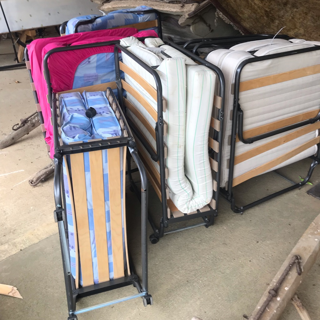 5 beds with mattresses and an extra 5 mattresses available