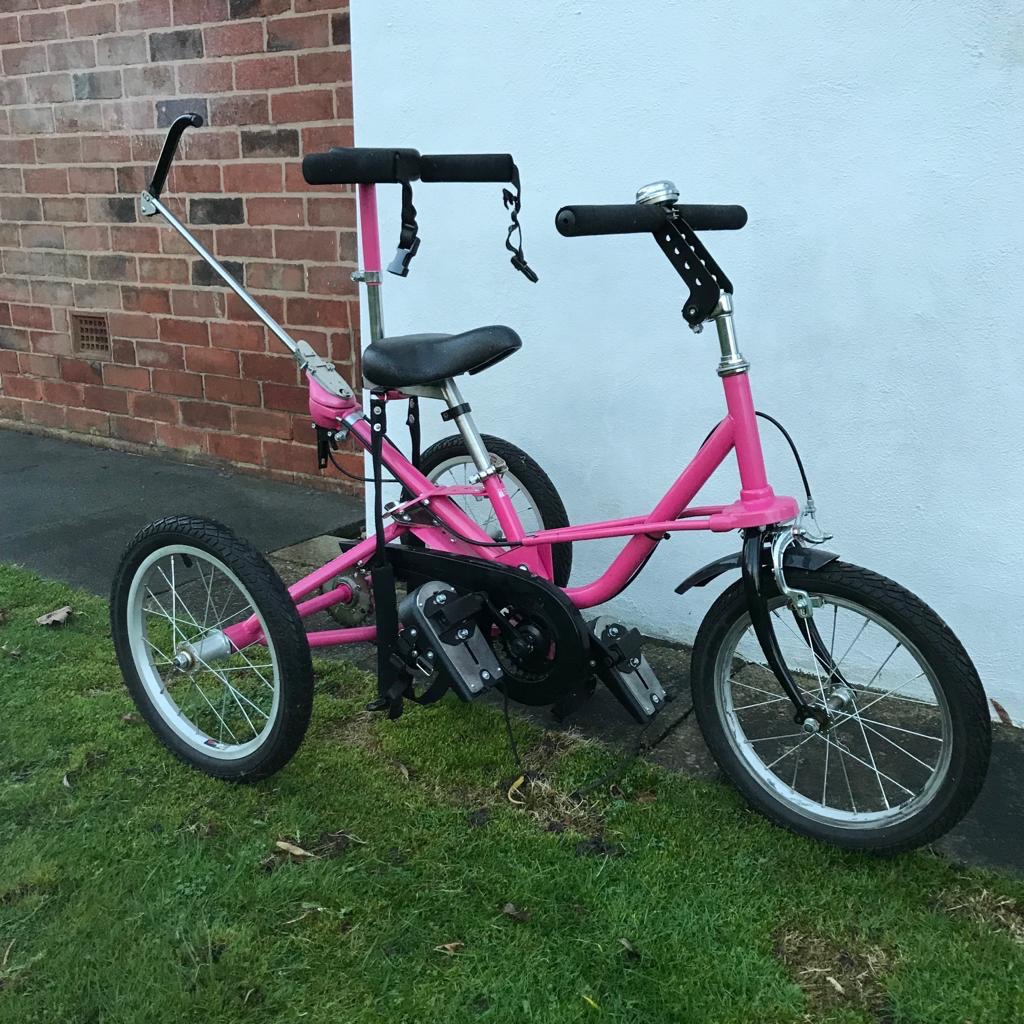Pink Tomcat Trike for child with learning difficulties