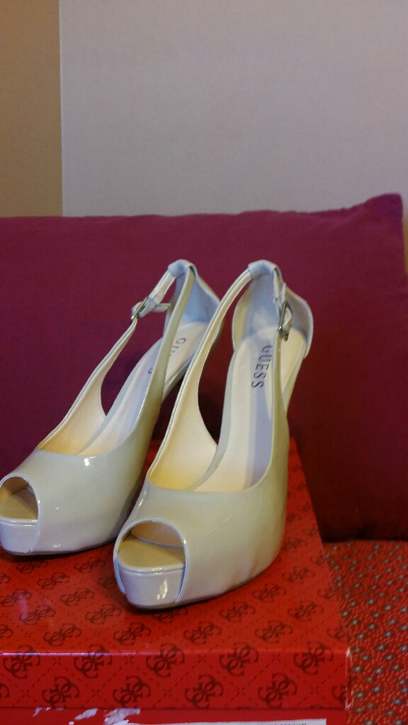 Guess beige high heels shoes, size 7