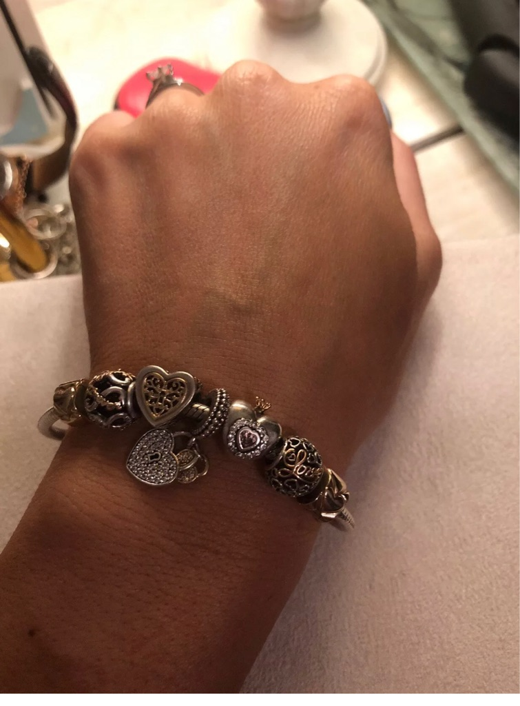 Pandora 14ct gold and silver bracelet with charms