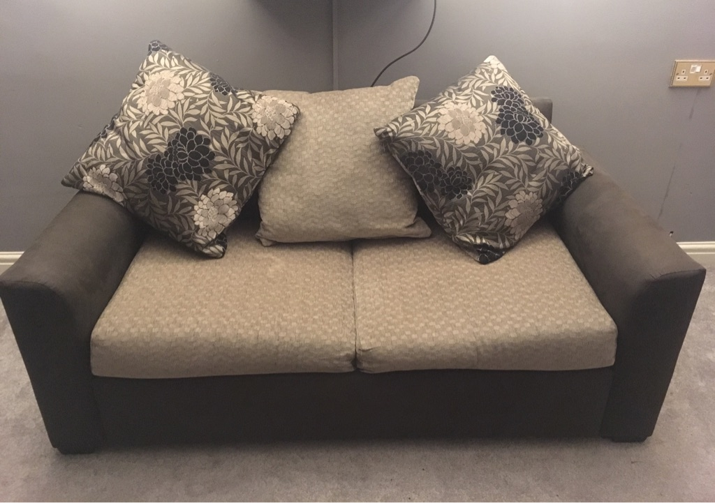 Two seater sofa/sofa bed with cushions