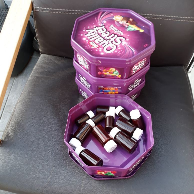 4 EMPTY QUALITY STREET TUBS  & 12 small pill bottles