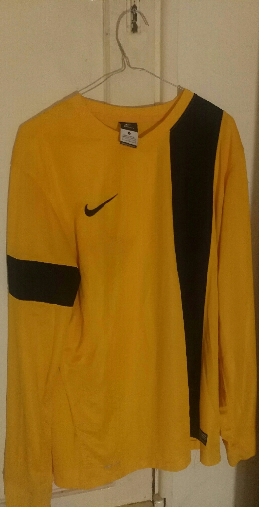 Nike yellow striped sports jersey