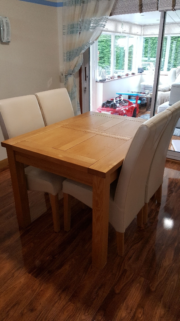 artisan solid oak dining table and 4 cream leather chairs with solid oak legs cost £1500