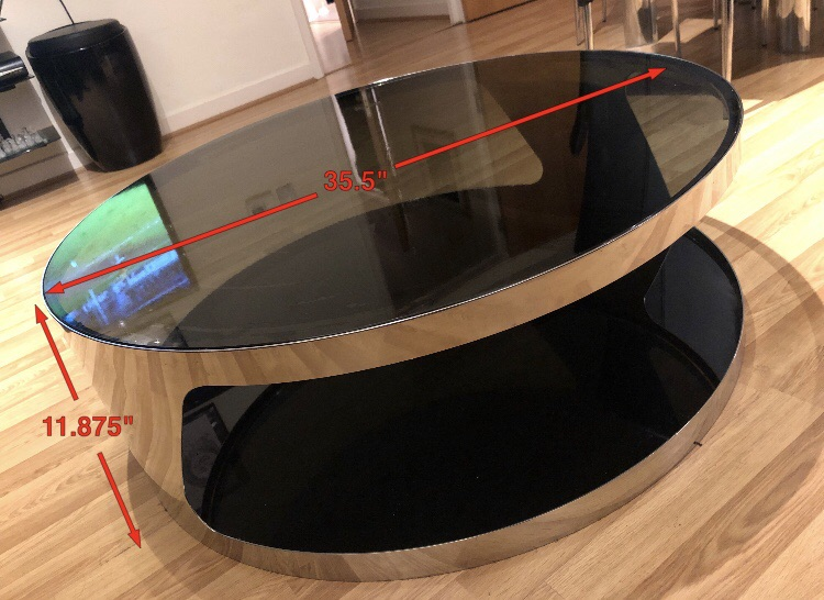 Round glass and steel coffee table