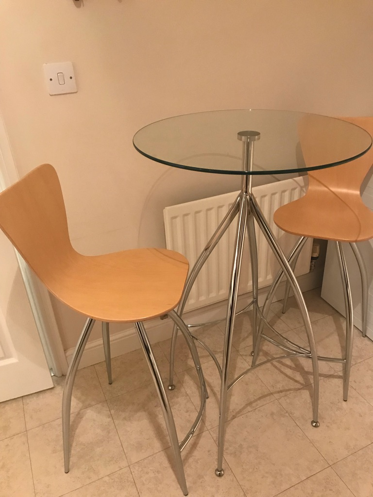 Glass table with bar stools