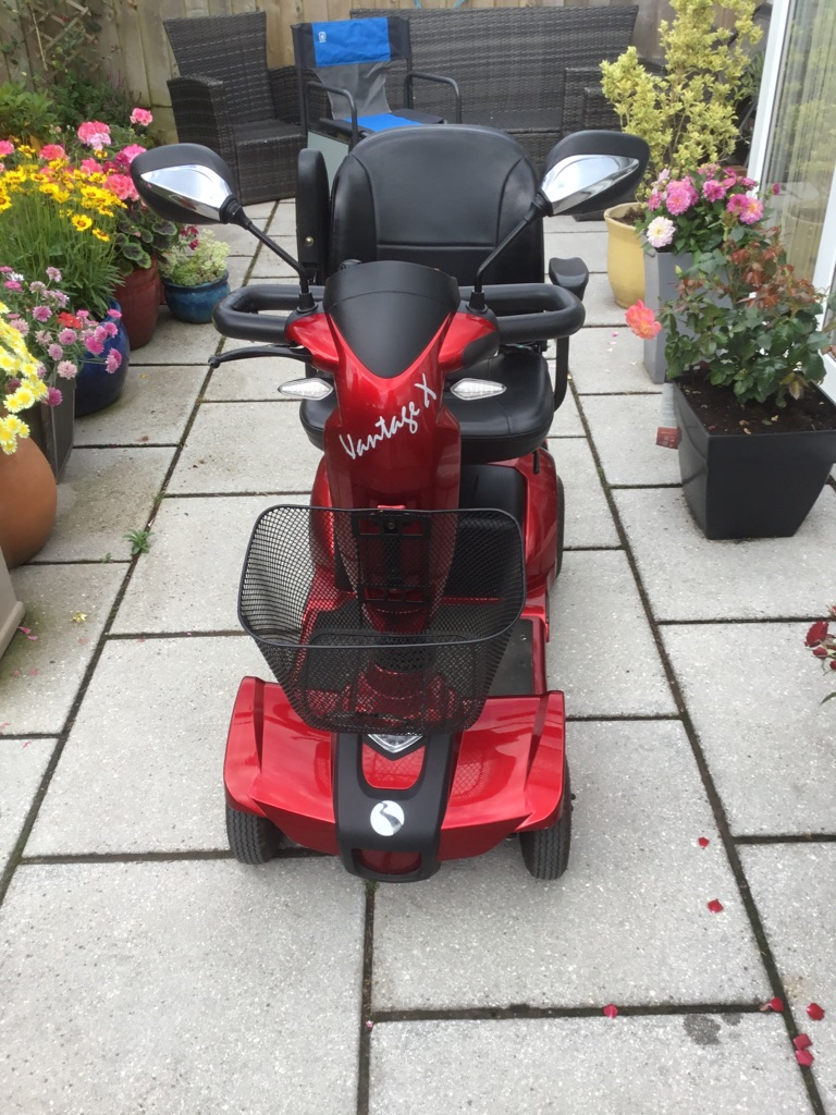 Rascal Vantage X mobility scooter complete with outdoor cover
