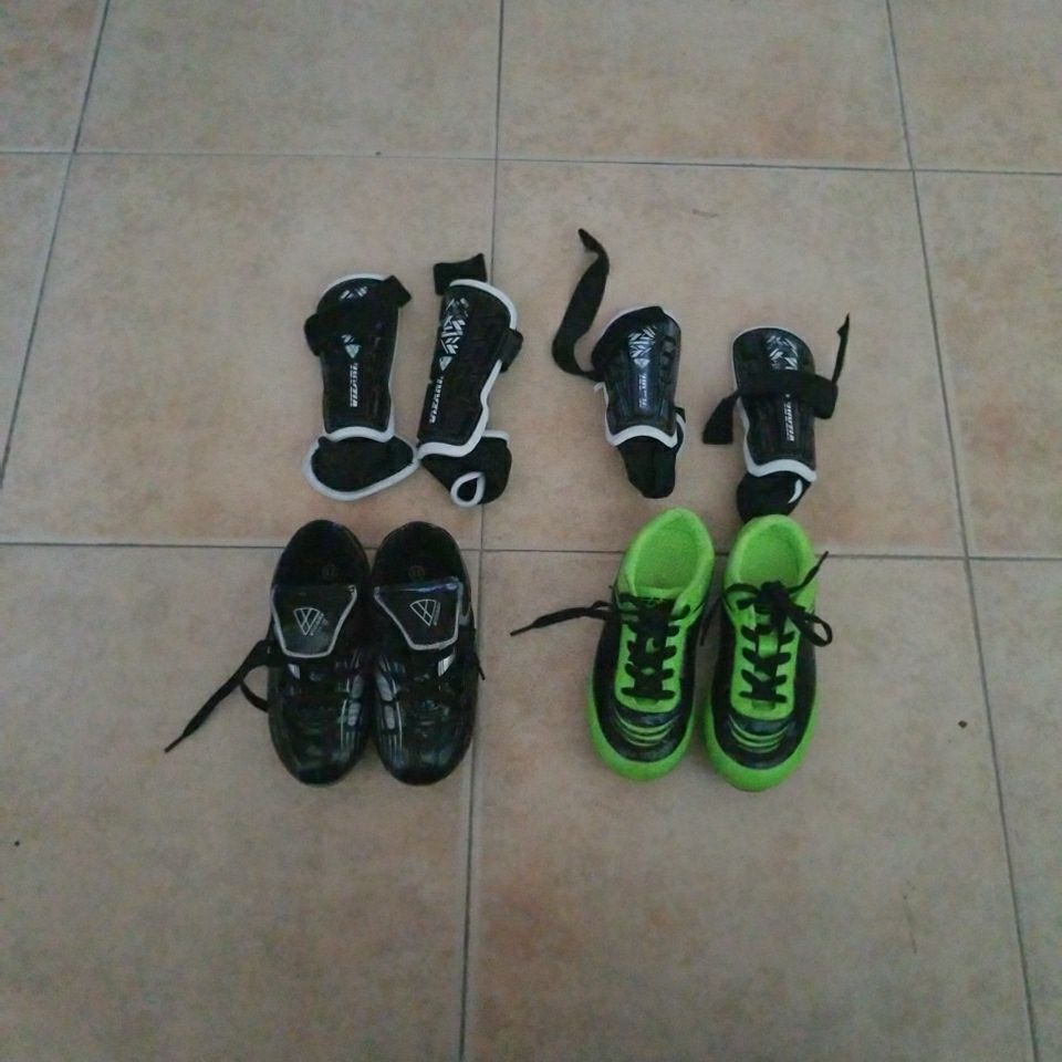 BOTH SOCCER SHOES ARE SIZE 11 KIDS SIZE WITH CHIN GUARD IF YOU BUY ONE IS $15.00 IF YOU BUY BOTH IS $25.00
