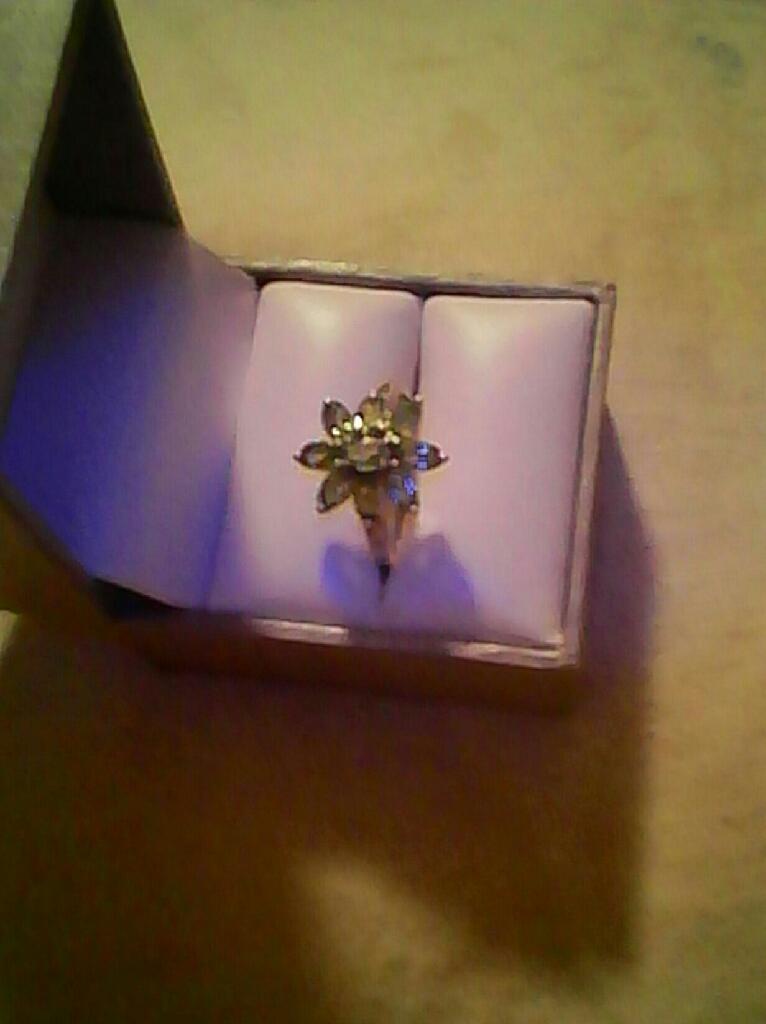 Genuine Peridot Ring..5 kts.  $40. Firm