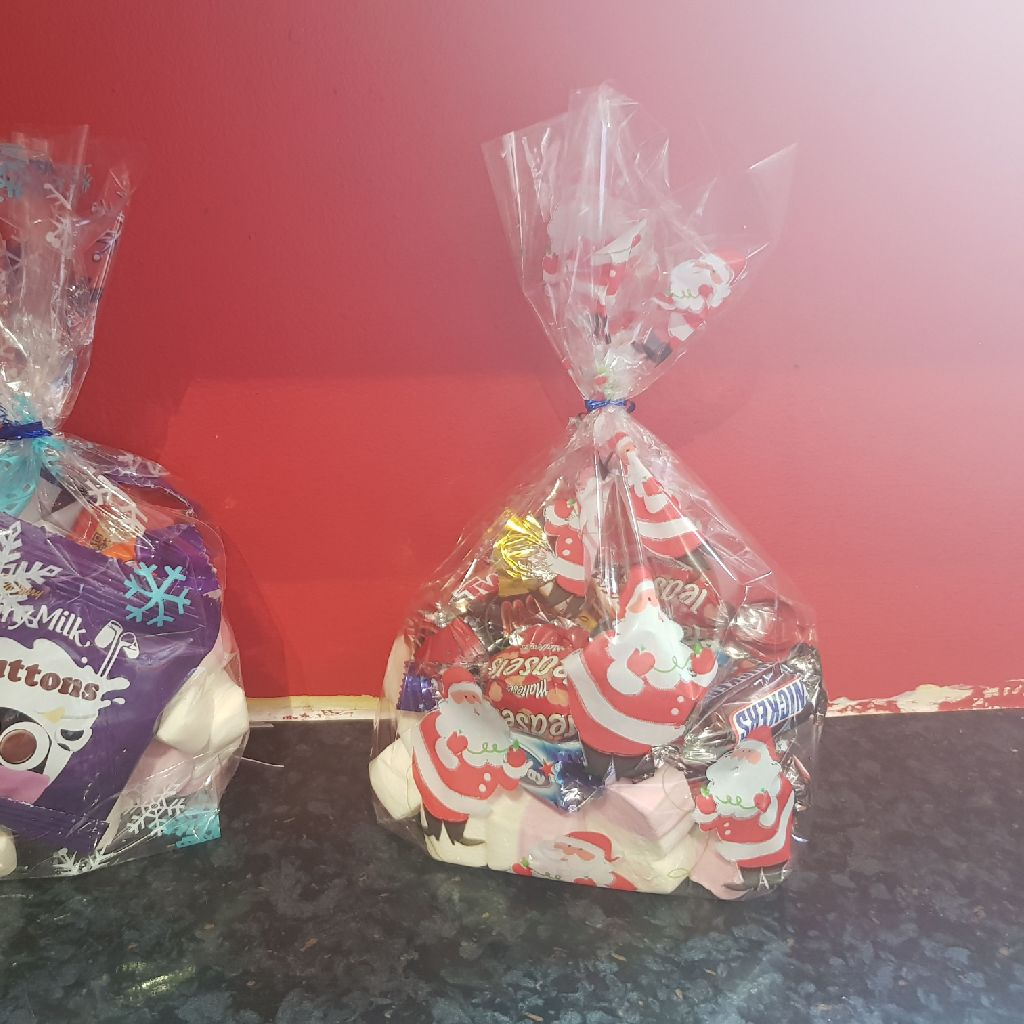 Celebrations and marshmallow bags £2