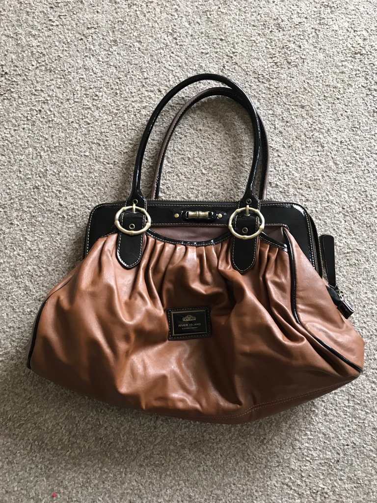 Brown River Island bag with black trim