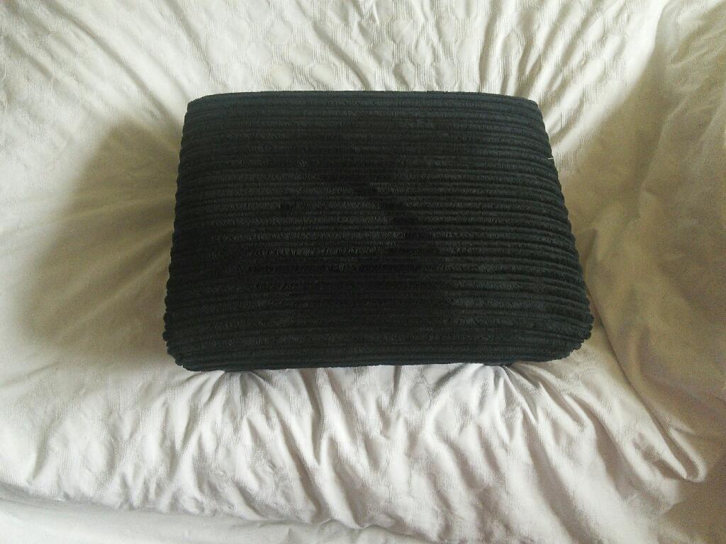 Two black jumbo cord footstools