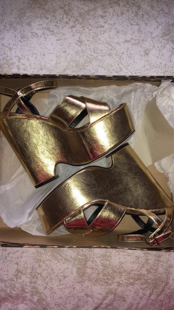 Women's gold wedges.