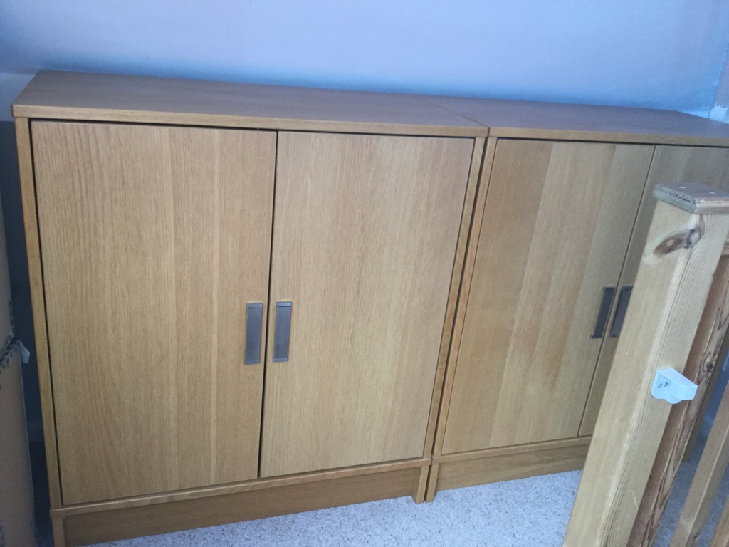Two Storage cupboards with three shelves inside