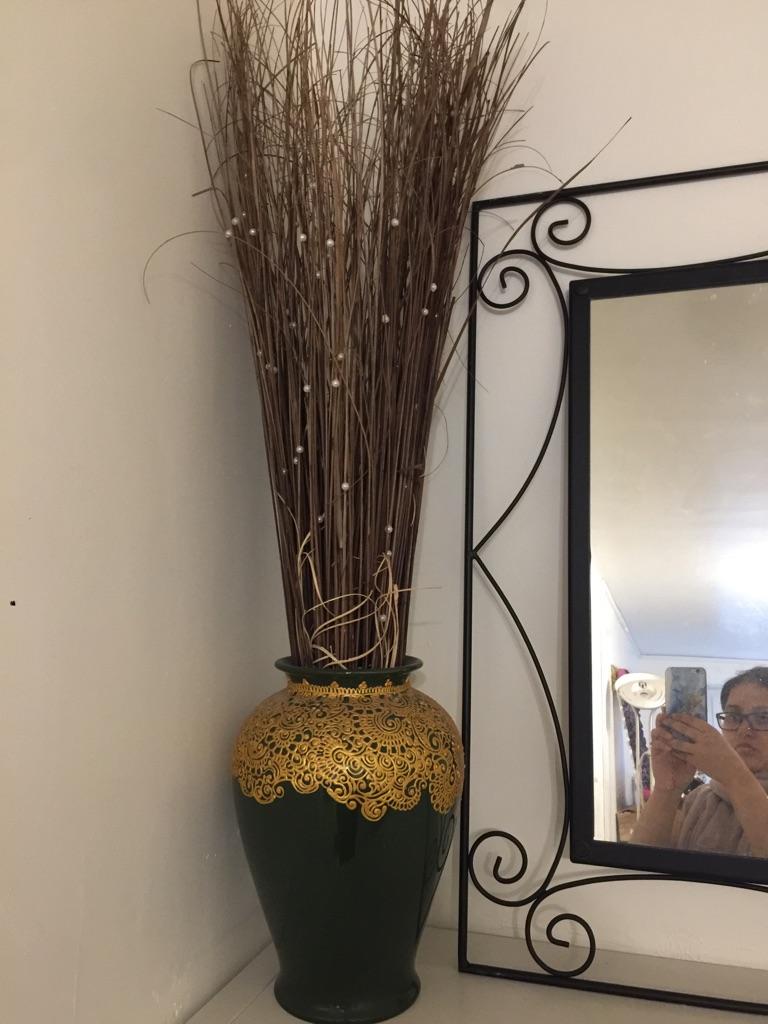 Henna green vase with sticks