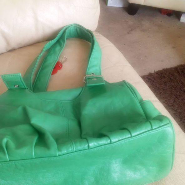 A small green handbag