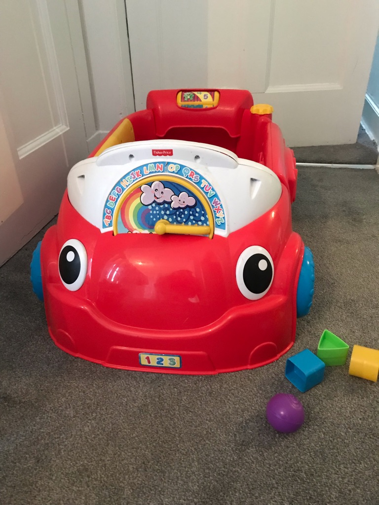 Fisher price laugh learn & crawl around car