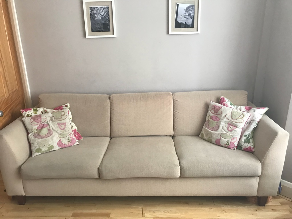 Four seat sofa and matching ottoman for sale. Preloved. Good condition.