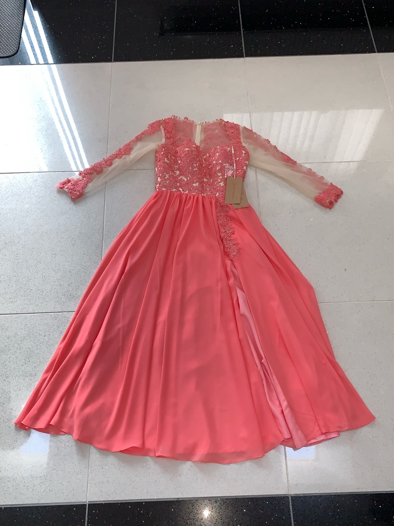 Watermelon pink long sleeved occasion dress