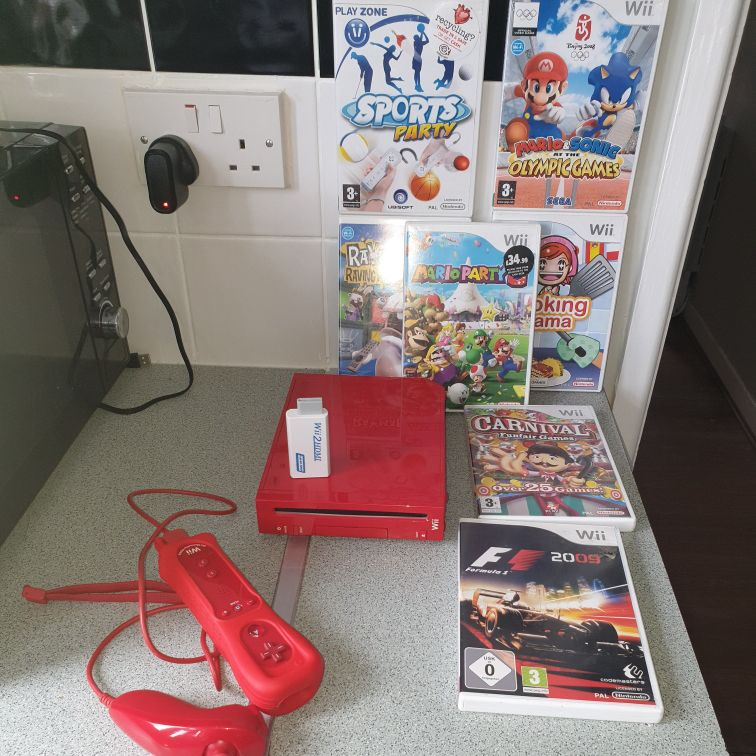 Red Wii with 7 games and HDMI converter