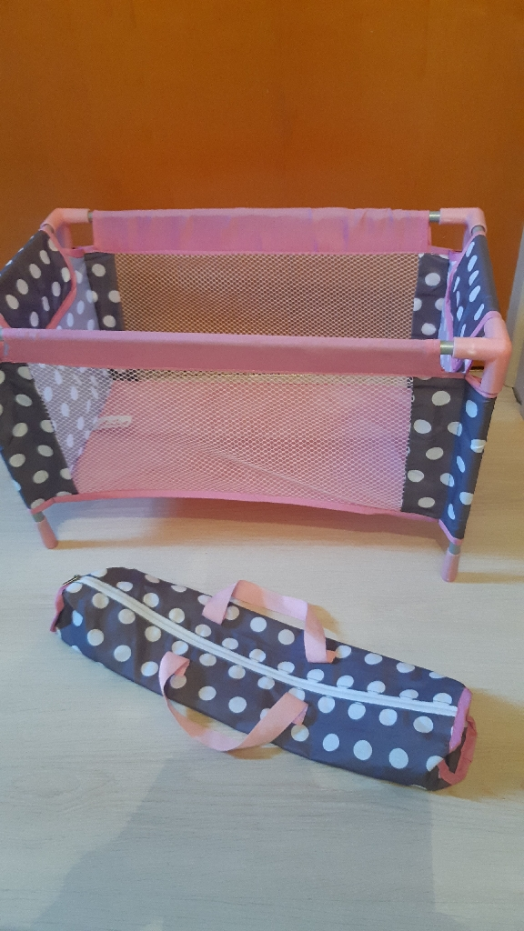 Pink toy cot