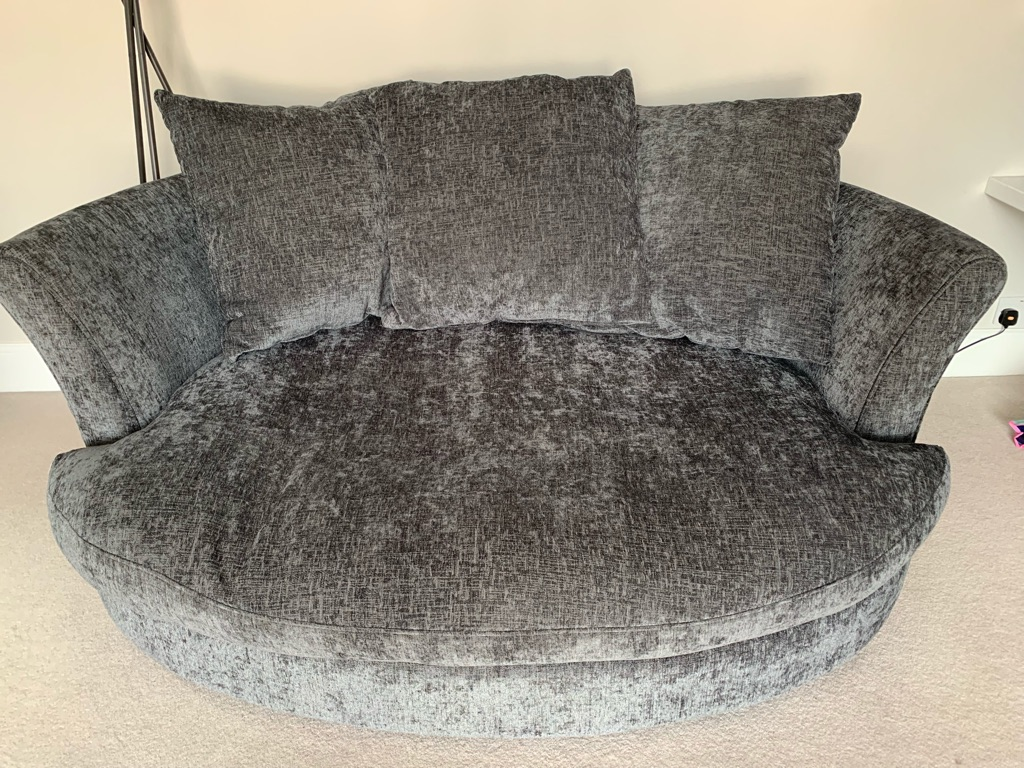DFS Grey 4 Seater Sofa and matching Cuddle Chair