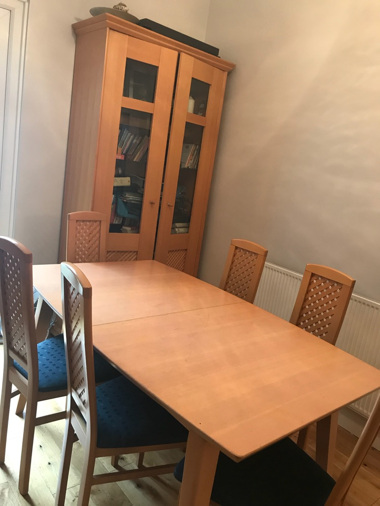 Table and chairs with matching cabinet